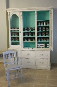 Paint cans and Wax in the new cabinet.